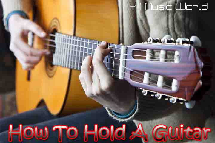 How To Hold A Guitar